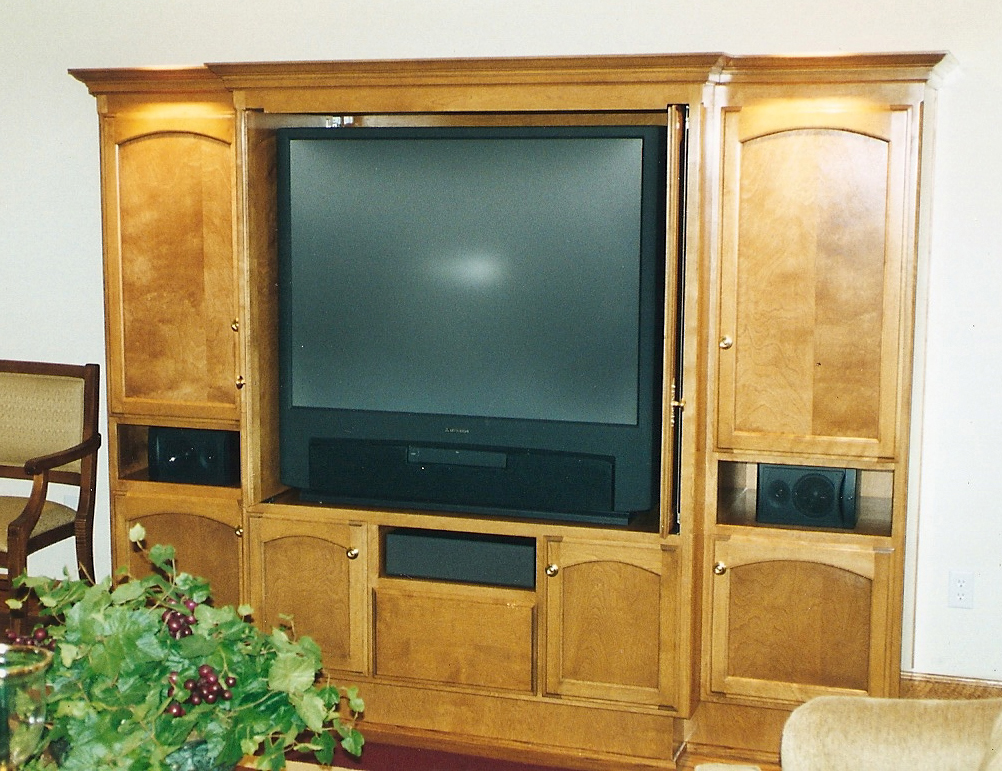 Mt eden cabinet media center samplesmedia center in solid maple with bird 39 s eye maple veneer - Retractable kitchen cabinet doors ...